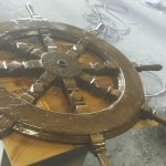 Ship's Wheel On Table